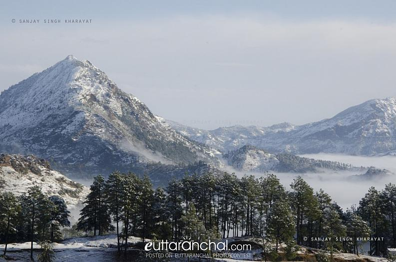 Snow white peaks in a Misty Morning