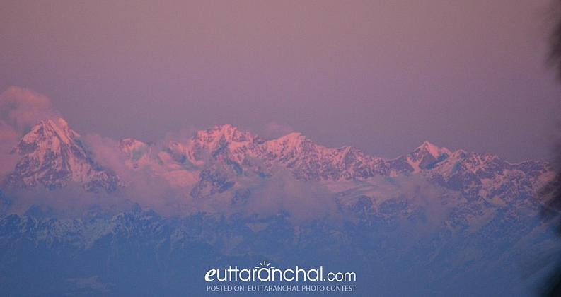 Snow clad Nandadevi range gets soaked in violet ray from setting sun