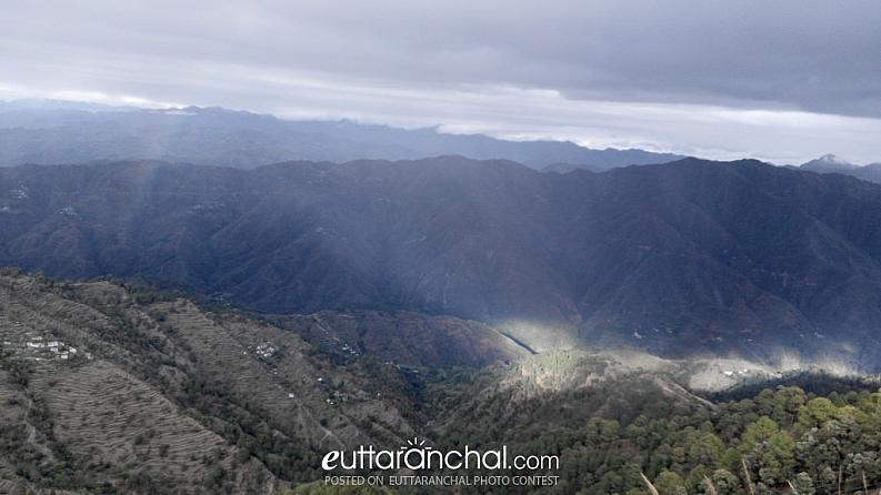 Sunlight in one portion of hills and Mildly rainbow….Awesome…