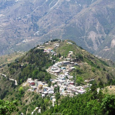 A serene Village in the Lap of Mountains..!